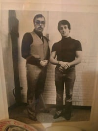Autographed photo of Sylvester Stallone and a producer