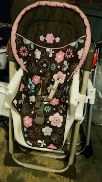 baby's pink, black and white floral print stroller