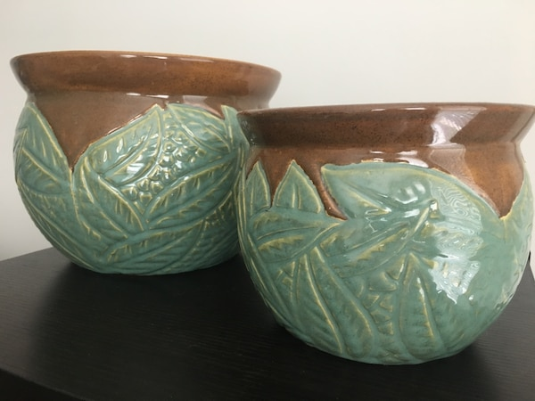 two green-and-white ceramic bowls