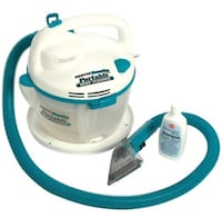 BRAND NEW IN BOX portable steam vaccum cleaner