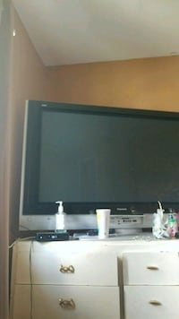 """black and gray flat screen TV 60""""  Monmouth County, 07721"""