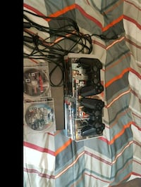 black Sony PS3 slim console with controller and game cases Edmonton, T5W 0P3