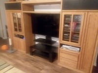 OLIVER SPRINGS TENNESSEE,,TV in center,  not included. Large Entertainment Center, glass doors, bridge with light, holds tons of VHS, CD, DVDs. Well taken care of.  Need gone Saturday.   CHARLOTTE