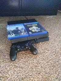 black Sony PS4 console with controller and game cases Springfield, 65807