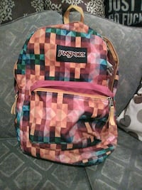 pink and multicolored Jansport backpack 619 km