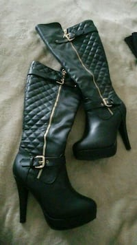 pair of black leather knee-high boots Phenix City, 36870