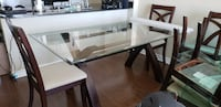 Dining room table - Glass top with dark brown and  Los Angeles