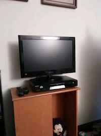 black flat screen TV with brown wooden TV stand St. Charles, 60174