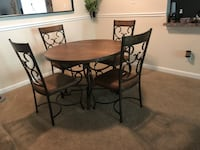 Round brown table with four chairs dining set 40 km