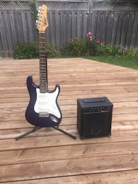 Purple electric guitar, stand and mini amp Ottawa, K1B 5G1
