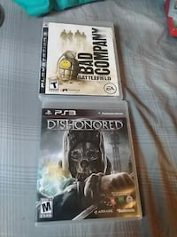 two Sony PS3 Dishonored and Bad Company Battlefield game cases