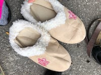 pair of brown-and-white fur slide sandals TORONTO