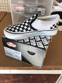 Pair of white-and-black vans sneakers. Concord, 94521