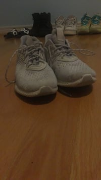 pair of white Nike running shoes Markham, L3R 4R4