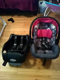 baby's black and pink car seat carrier College Station, 77840