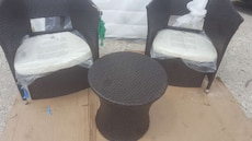 two woven black tub chairs
