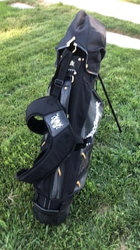 McGregor Tourney golf bag and Tommy Ariosto golf clubs plus a Carnite putter. Sparks, 89436