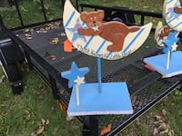 Blue, brown, and beige bear on a crescent moon wooden baby decor