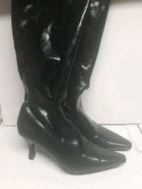 pair of black leather knee-high boots Calgary, T3J 3J1