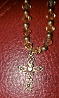 Gold plated cross/crystal necklace.
