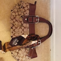 brown and black Coach monogram shoulder bag 12 km