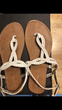 pair of brown leather thong sandals Aston, 19014