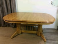 oval brown wooden dining table 48 km