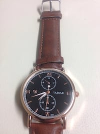 Round brown yazole chronograph watch with brown leather strap