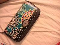 blue and black leather wristlet Rocky Mount, 27804