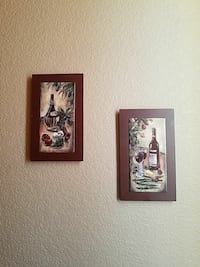 two painting of glass bottle and drinking glasses