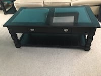 Black wooden framed glass top coffee table