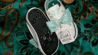 toddler's pair of white Time To Lace shoes