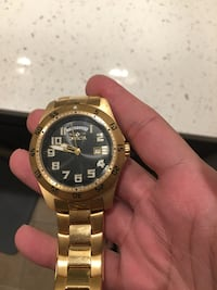 Gold men's invicta watch