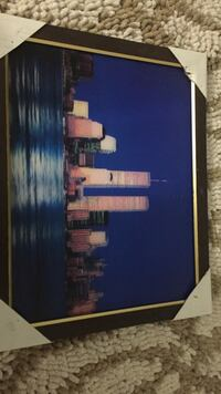square black wooden-framed city building painting