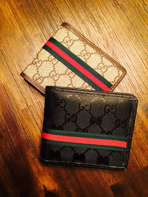 two black and white leather Gucci wallets 3b2c4c54-8706-40d5-a5f2-31a2df06df8f