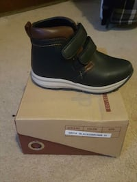 unpaired black and brown leather velcro shoe with box