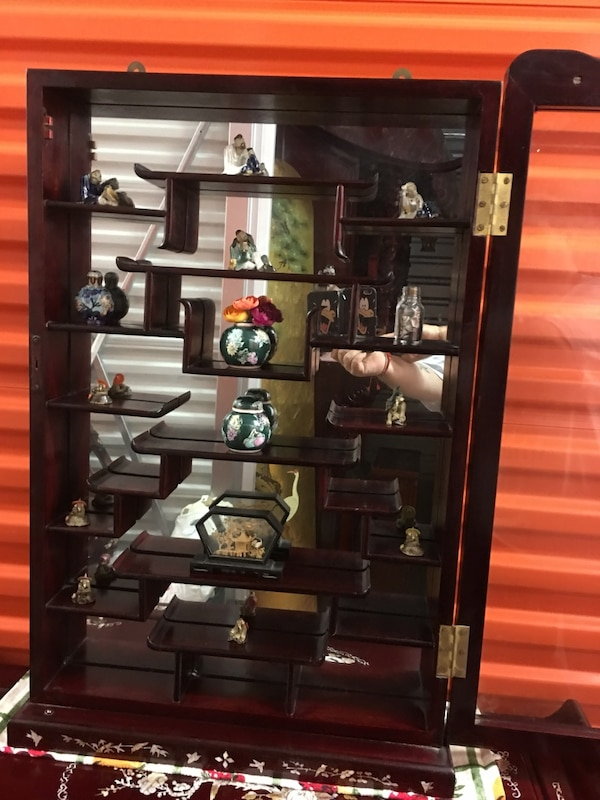 Chinese Display Cabinet. Mother of Pearl. Rosewood. 24 small ornaments included. The price is firm. 32 1/2 inches high, 22 inches wide .