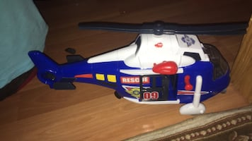 Blue and white plastic toy helicopter