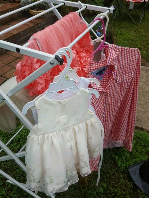 baby's pink and white bassinet
