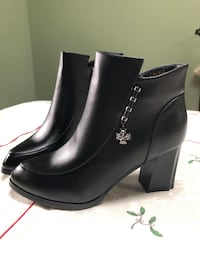 pair of black leather side-zip chunky heeled booties Franklin Square, 11010