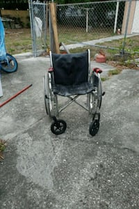 black and gray folding wheelchair
