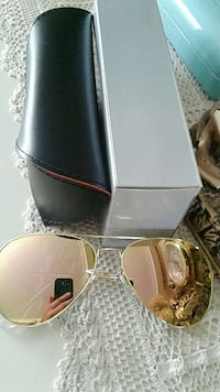 amber lens sunglasses with black leather case and box