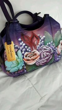 Genuine leather handpainted purse. Cost $240.  Simcoe, N3Y 3S6