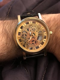 Round gold-colored chronograph watch with black leather strap Edmonton, T6R 0T6