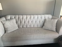 Grey couch with rhinestone buttons $300 Calgary, T2H 0N9