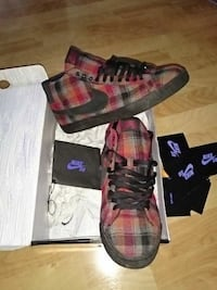 pair of red-and-gray plaid Nike high-top sneakers