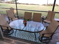 round clear glass-top table with black steel base Naples, 34113