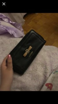 black and gray leather wallet 548 km