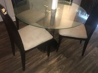 round glass top table with four chairs dining set Atlanta, 30349