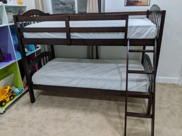 Twin bunk bed with ladder.  817ebfee-46ba-4c75-86d0-cc5b70885399